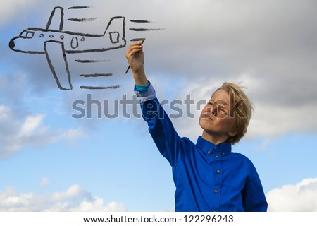 kid painting airplane