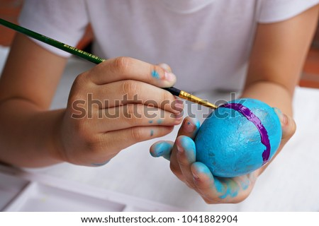 Kid painting color on egg prepare for Easter