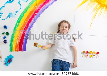 kid painting rainbow