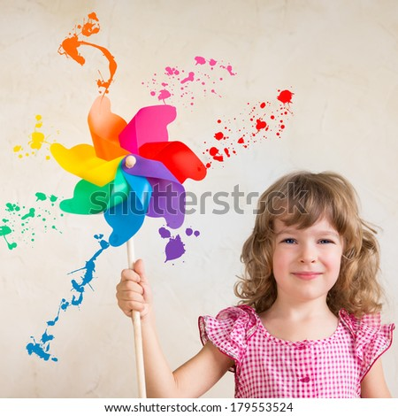 Kid painting wall. Spring renovation concept