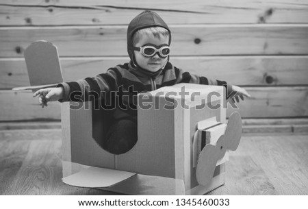 Kid, pilot school, innovation. Pilot travel, airdrome, imagination. Air mail delivery, aircraft construction. Dream, career, adventure, education. Little boy child play in cardboard plane, childhood.