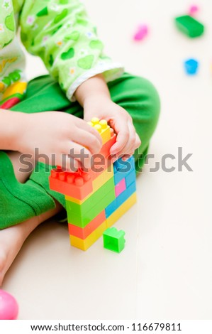 kid play plastic toy - stock photo