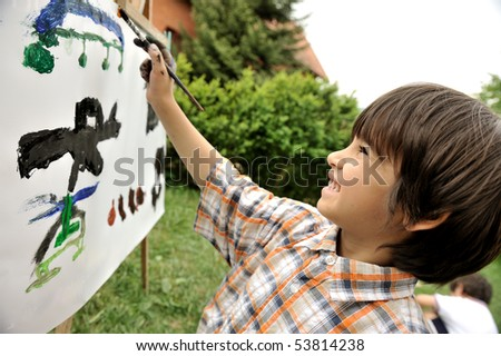 Kid playing and drawing outdoor, war equipment