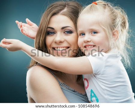 Kid playing isolated portrait. Young mother girl.