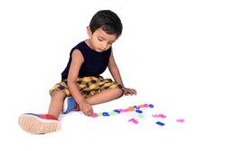 Kid Playing with Alphabets