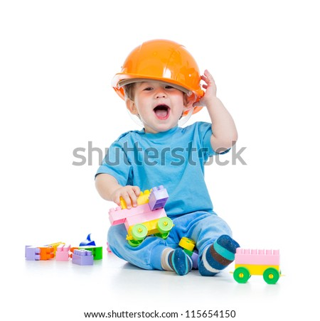 kid playing with building blocks toy isolated on white