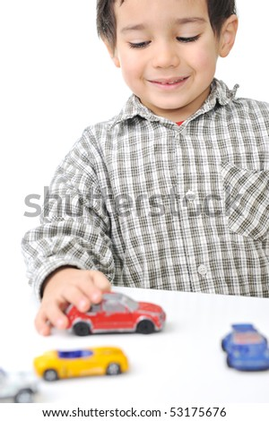 <b>Kid playing</b> with cars - stock-photo-kid-playing-with-cars-53175676