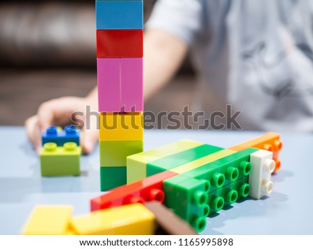 Kid playing with color toy blocks #1165995898