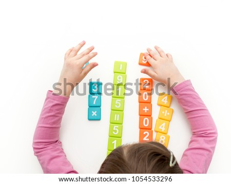 Kid playing with numbers isolated on white background. Math concept
