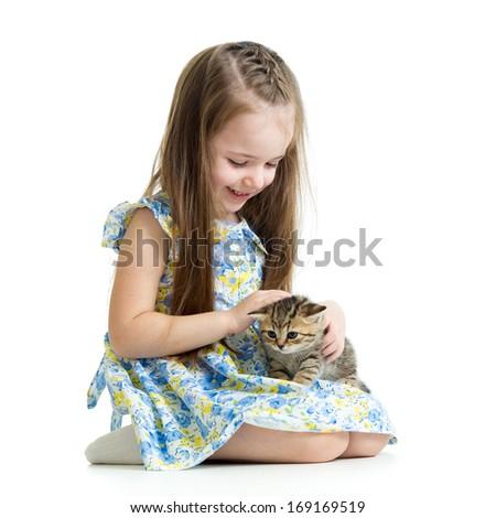 kid playing with Scottish kitten