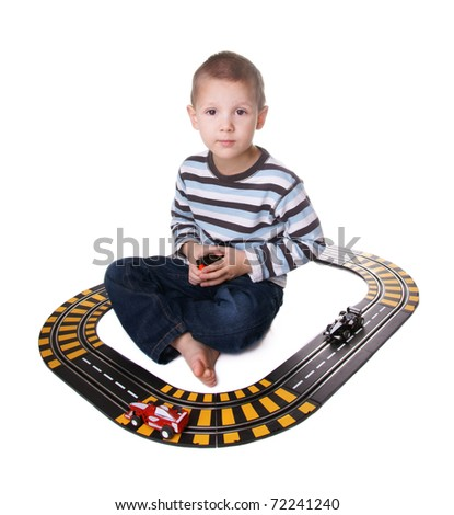 Kid playing with toy car trek isolated on white background