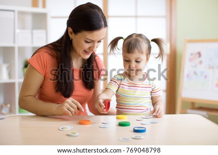 Kid plays logical game at the lesson of a psychologist #769048798
