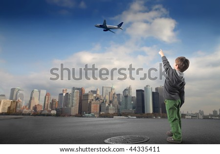kid pointing flying airplane