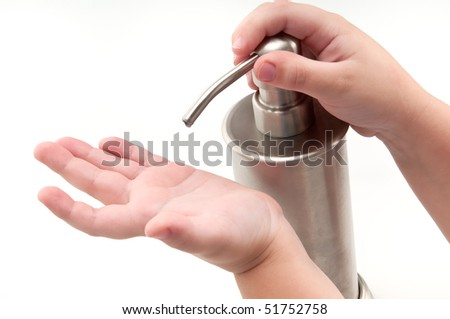 Kid pouring alcohol-based sanitizer himself. Isolated on white.