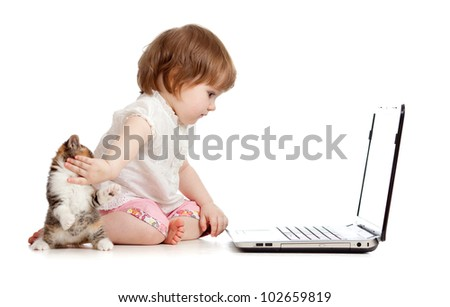 kid protecting notebook from kitten