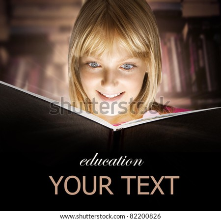 Kid reading the Book. Education - stock photo