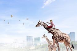 Kid ride giraffe . Mixed media