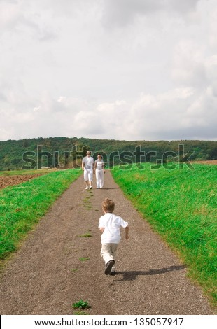 Kid runs on the way to his  parents.