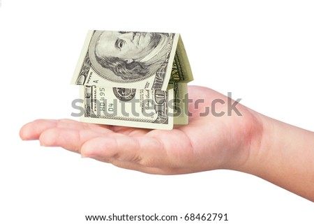 Kid's hand holding money house on white background