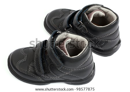 kid's shoes from the black leather isolated on white background