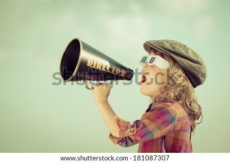 kid shouting through vintage...