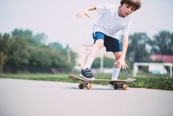 Kid skateboarder doing a skateboard trick.