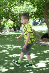 Kid. Summer active game. Outdoor gymnastics, kids sport. Children are engaged in sports, gymnastics, fitness. Child is engaged in sports in park. Summer outside activity. Boy, toddler engaged in sport