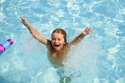 Kid swimming. Children summer vacation. Summertime. Attractions concept Swimmingpool