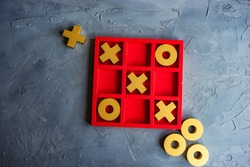 Kid tic-tac-toe board game concept on concrete background with copy space