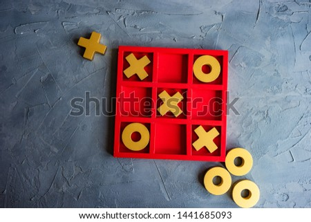 Kid tic-tac-toe board game concept on concrete background with copy space Foto stock ©