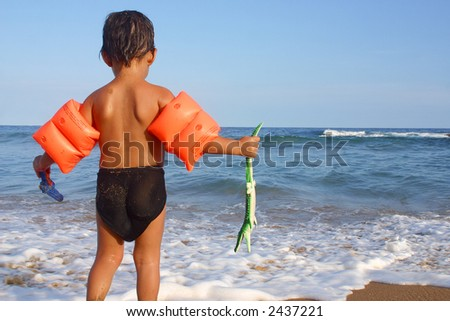 kid watching the shore at the bay of San Agustinillo in the southern state of Oaxaca in Mexico, Latinamerica