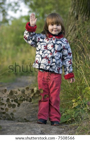 Kid waving for goodbye standing alone before long way in the treesKid Standing Alone