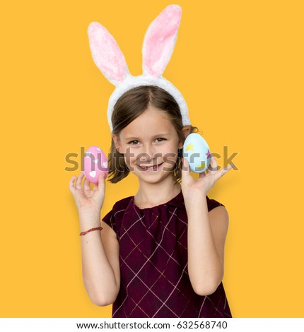 Kid with a bunny hairband holding eggs #632568740