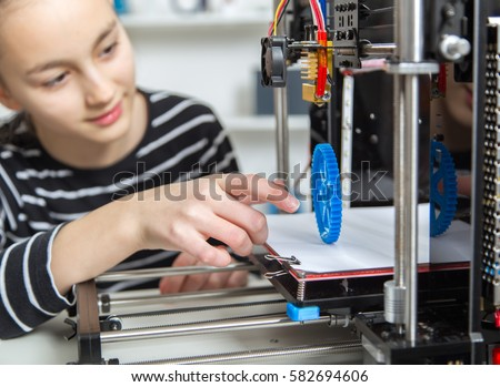 kid with 3d printe. education, technology,
