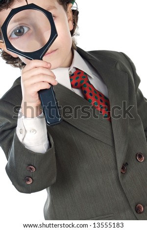 Kid with magnifying glass a over white background