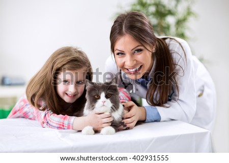 Kid with pet cat at the veterinary doctor
