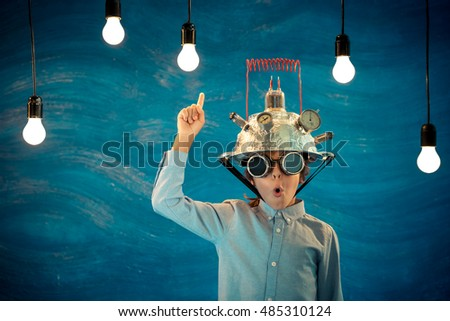 Kid with toy virtual reality headset. Child playing at home. Success, creative and innovation technology concept