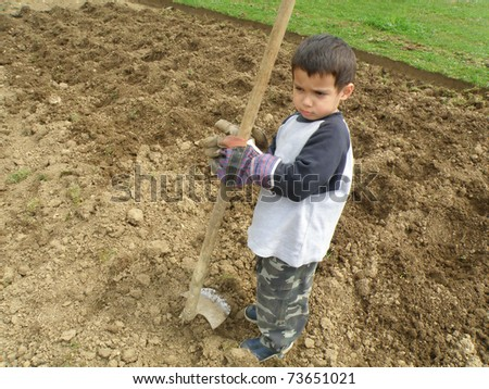 Kid working on land