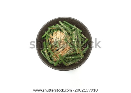 Kidney beans with grind sesame dressing in the bowl isolted on a white background. Stock photo ©