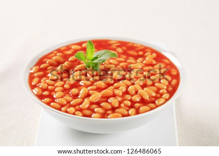 Kidney beans with tomato sauce in a porcelain bowl