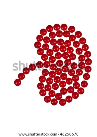 Kidney shape made out of red tablets on a white background