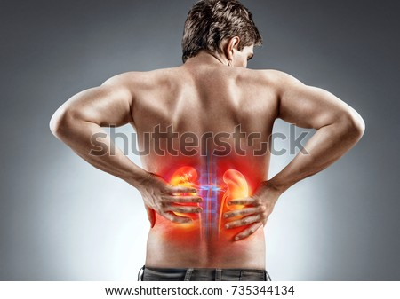 Kidneys pain. Man holding his back. Medical concept.