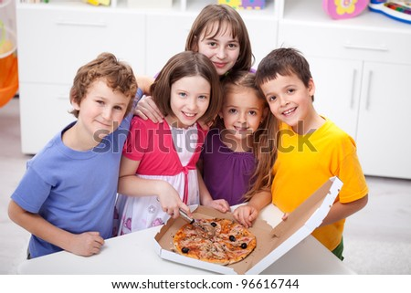 Kids at home preparing to eat pizza - stock photo