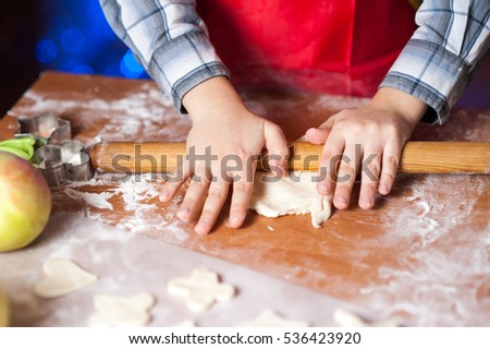 Kids baking cookies in the kitchen and decorate cookies on Christmas Eve - Shutterstock ID 536423920