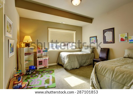 Kids bedroom with twin bed sets, a window and carpet.