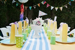 kids birthday party decorations bright and colorful with balloons bunting candy and gift bags