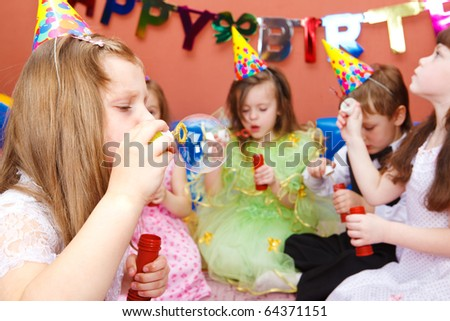 Kids blowing bubbles at the birthday party