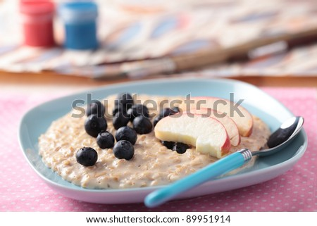 Kids breakfast with oatmeal porridge and fruits