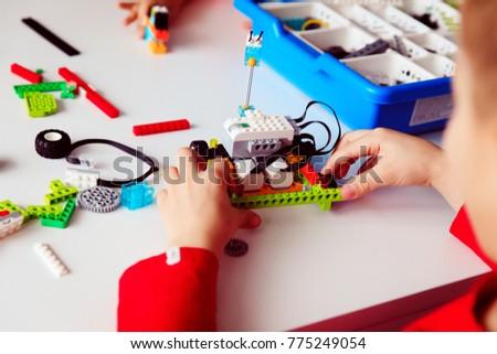 kids building robot at robotic technology school lesson