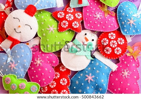 Kids Christmas background. Cute felt ornaments for Christmas. Felt Christmas trees, snowmen, hearts, stars, mittens toys. Top view  #500843662